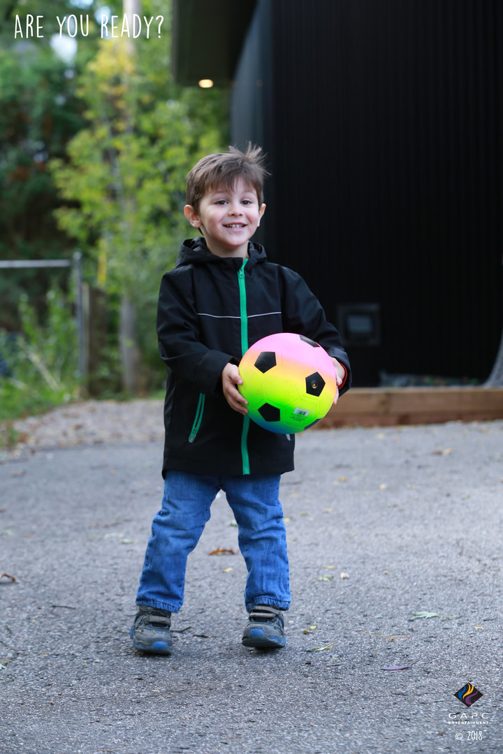 Eric_Playing Outside_With Ball.JPG