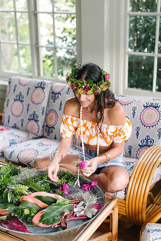 Beautiful lei maker crafting a tropical flower crown