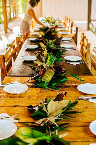 Woman setting beautiful tropical tablescape for event