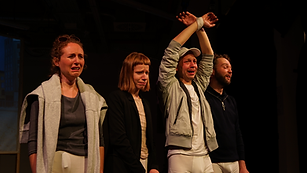 Picture from render ghost performance. Four actors crying while standing in line.