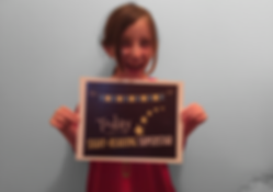 excited teen piano student holding award after playing easy piano song and chords