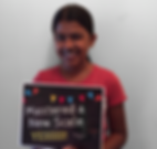 young female kid piano student smiling holding award for mastering a new scale