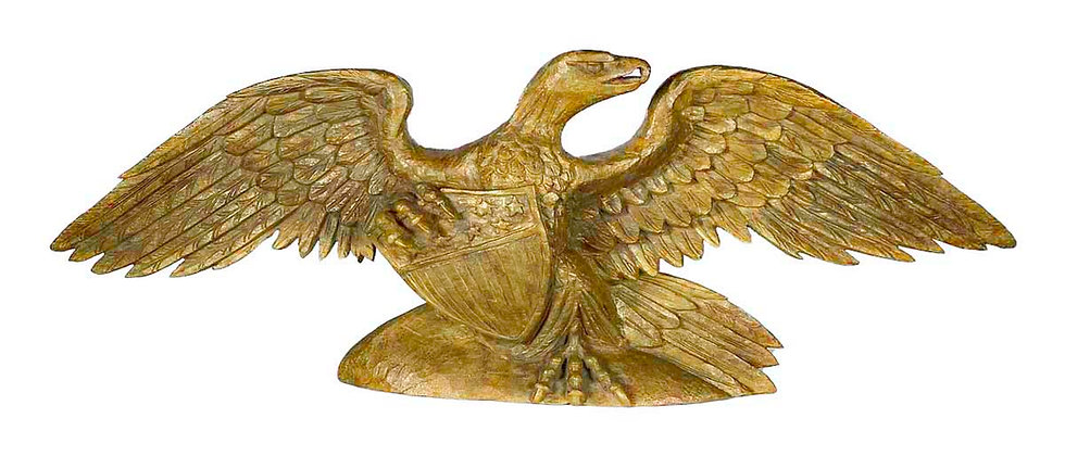 Carved and painted figure of a spread winged eagle