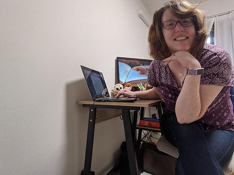 Editor Toni Suzuki sits at her work desk.