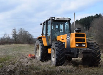 man driving tractor on smallholding course