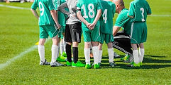 soccer-coach-giving-young-football-260nw