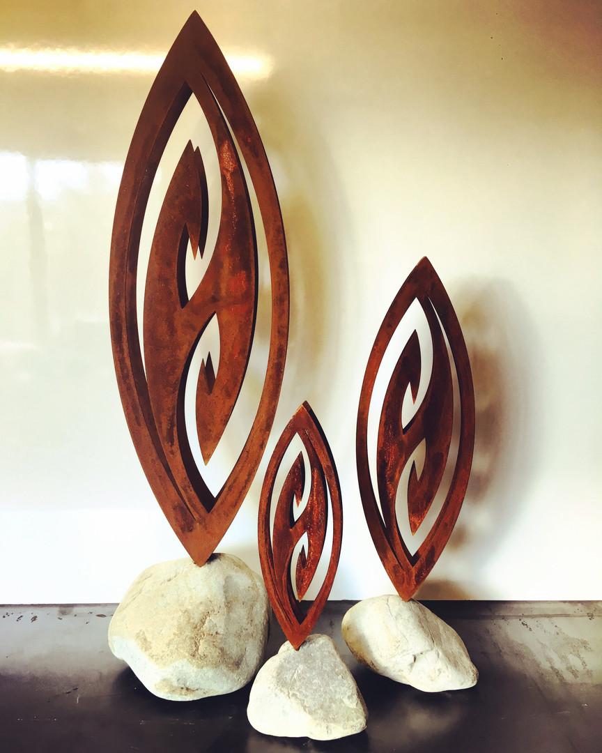 Trio of Corten fish hooks in stones - 900mm @ $675, 600mm @ $400 & 400mm @ $300
