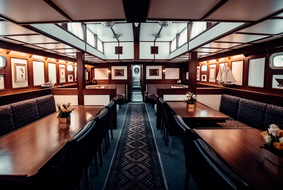 dining tables in the saloon aboard sailing yacht stella oceana