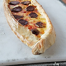 Pide with cheese and Turkish sausage (Sucuklu Pide)