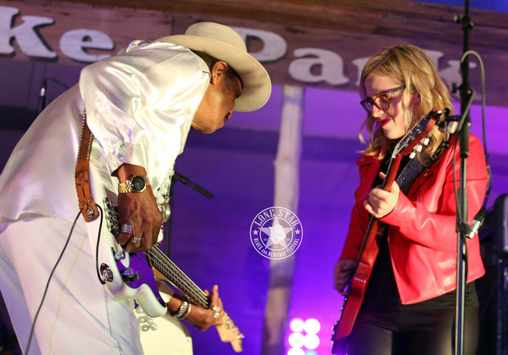 Benny jams with guitarist Meg Williams during their Saturday performance.