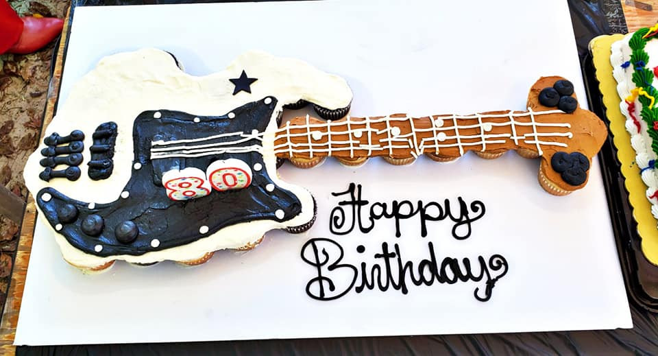 "A gorgeous ""cupcake cake"" in teh shape of Benny's bass!"