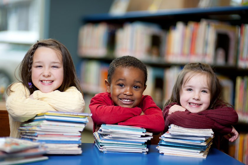Happy Kids with Books_edited.jpg