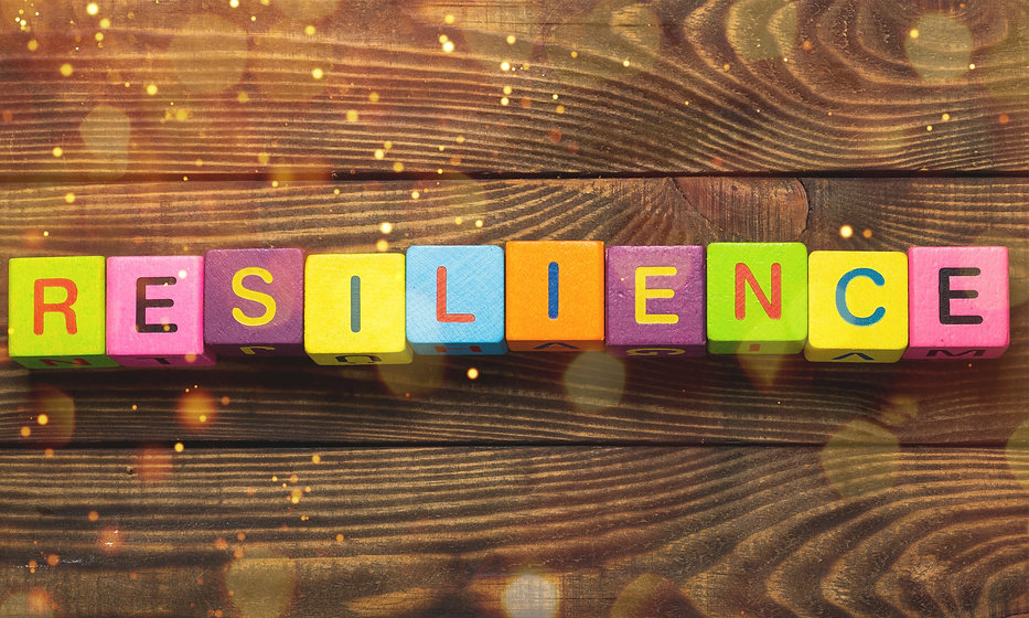 Resilience sign with wooden cubes on bac