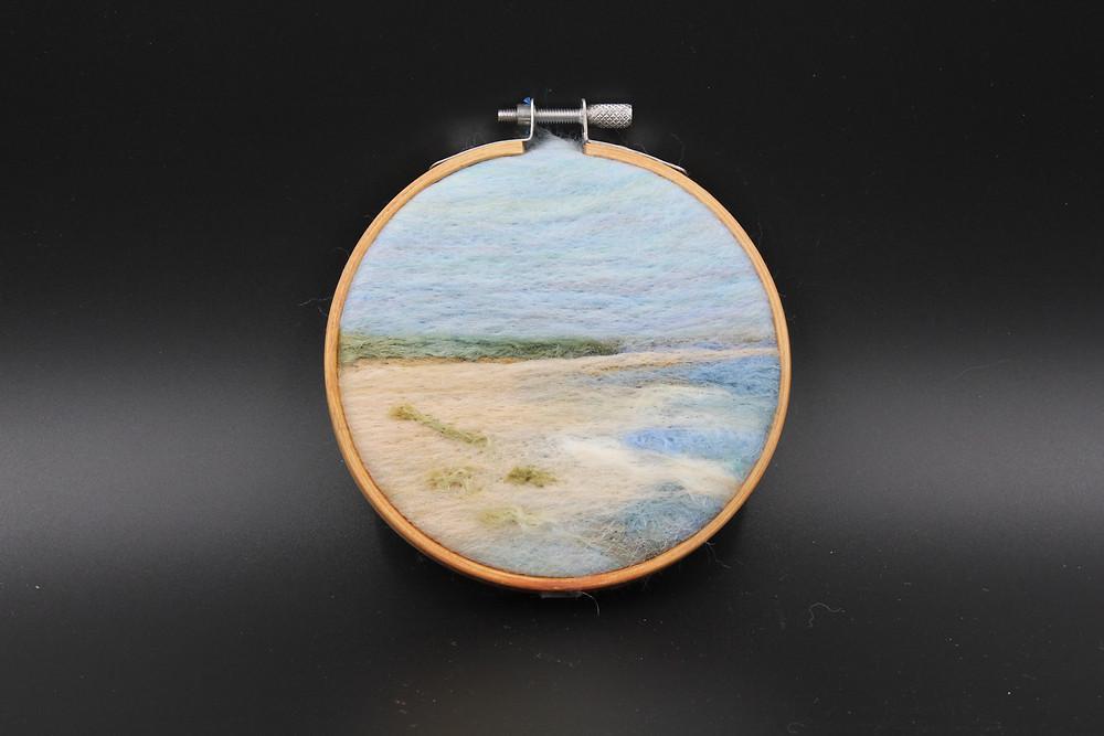"Needlefelt wool framed in 4"" embroidery hoop"