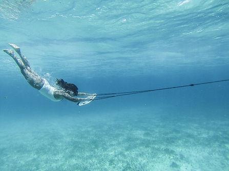 Girl-subwingin-clear-water_1600x.jpeg