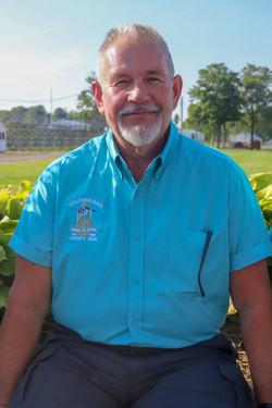 John C Wolf, President