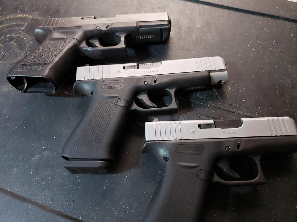 Photo of three Glock handguns