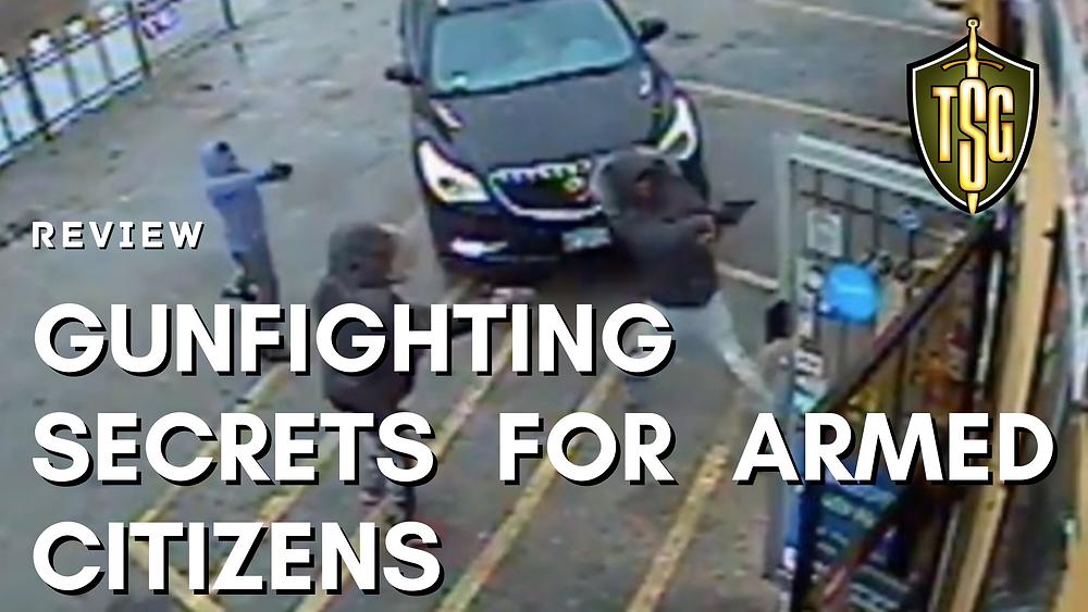 Three criminals pointing handguns at door of business
