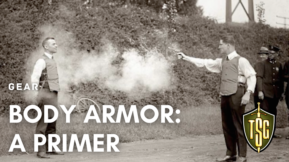 Man wearing body armor in 1923 testing bulletproof vest by being shot with a revolver.