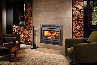 warm room with concrete stone wood burning fireplace