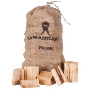 Light brown burlap bag of Kamado Joe pecan chunks with wooden chunks sitting infront of it