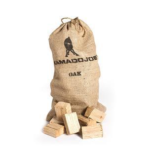 Light brown burlap bag of Kamado Joe oak chunks with wooden chunks sitting infront of it