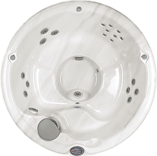 Circular white marble and silver Sundance Spa 680 series Denali hot tub