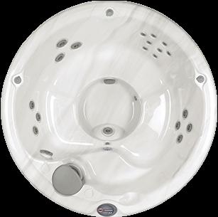 Circular white marble and silver Sundance Spa 680 series Denali hot tub
