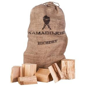 Light brown burlap bag of Kamado Joe hickory chunks with wooden chunks sitting infront of it