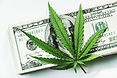 marijuana-leaf-on-top-of-stack-of-100-bi