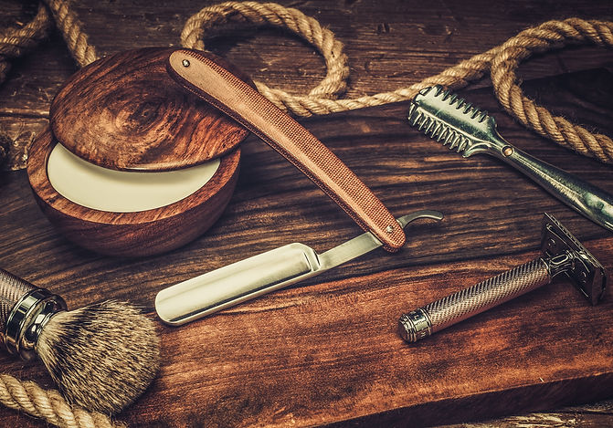 Shaving accessories on a luxury wooden b
