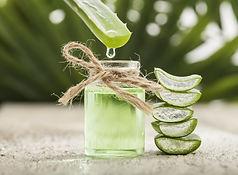 Aloe vera essential oil on tropical leav