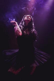 Slamboree dancer Adelina Shay on stage enjoying a fag-break