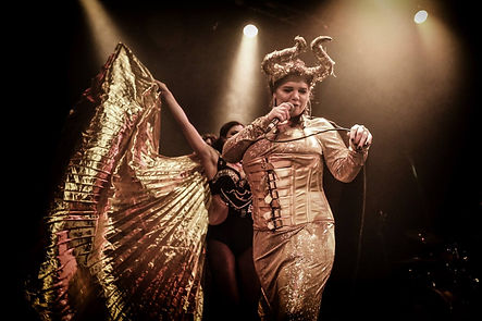 Slamboree's MC and powerhouse singer Kathika Rabbit in golden horns outfit