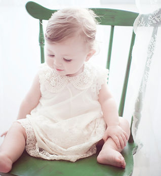 Child in Green Chair