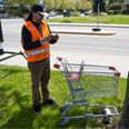 photo being taken of an abandoned shopping cart