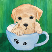 Puppy in a coffee cup