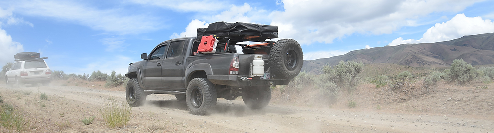 Toyota TRD equipped with a RackStarz Overlander off-road truck package, including a Yakima OutPost HD truck system, Yakima SkyRise tent, and multiple Yakima truck rack accessories