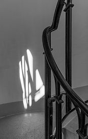 There is light at the top of the stairs_