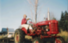 Miles-on-Tractor.png