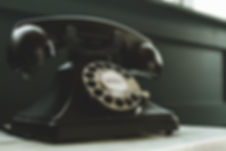 black-rotary-telephone-on-white-surface-