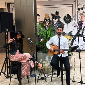Public show at Westfield, Warringah Mall.  Sydney acoustic duo.
