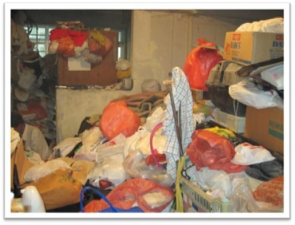 His flat was so stacked up with items he collected from outside that the door could not open fully. (Source: O'Joy case photo)