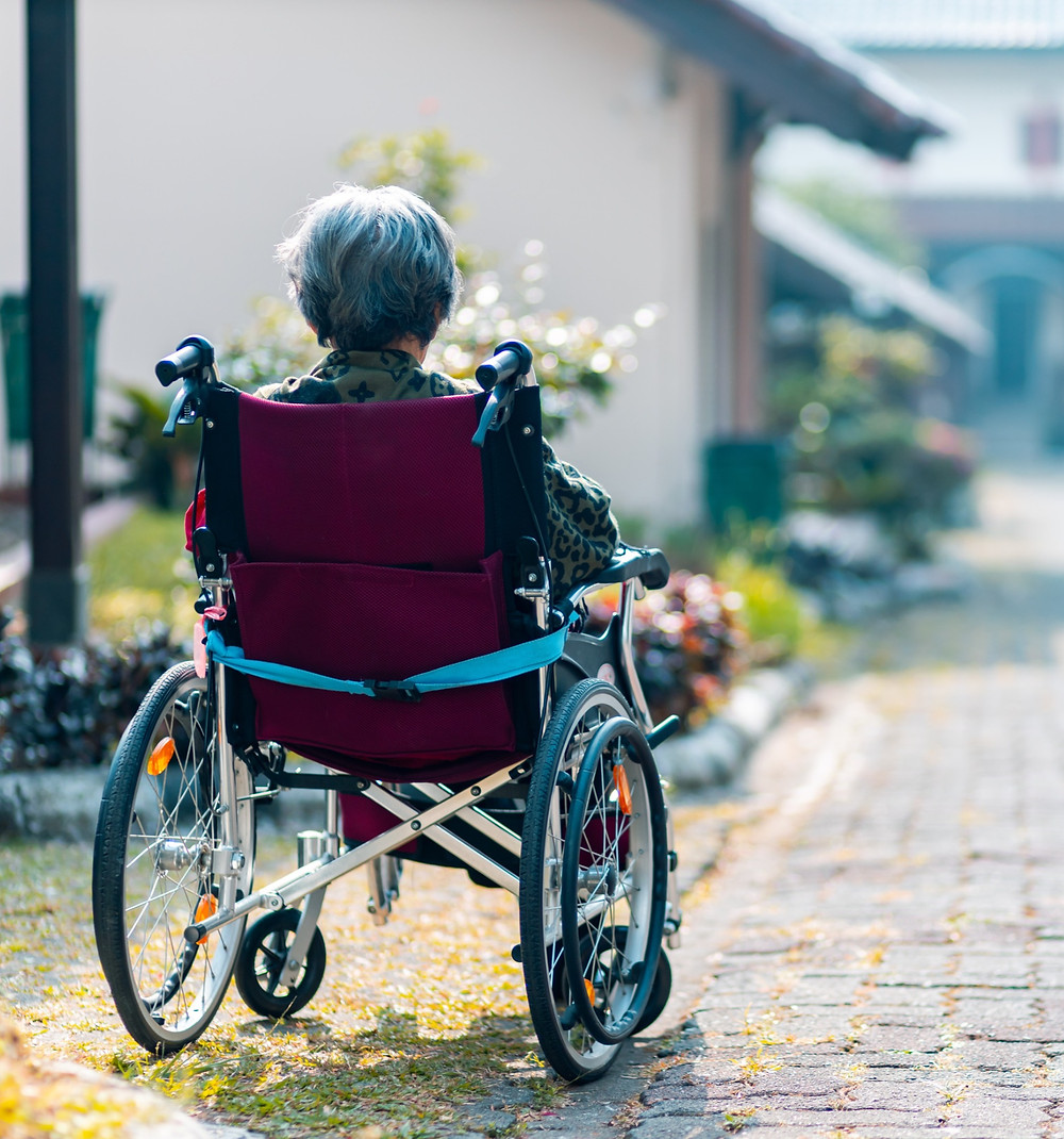 Elderly lady in wheelchair
