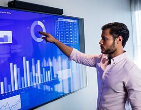 businessman-analyzing-data-with-a-touch-screen-2021-04-04-22-35-56-utc_edited.jpg