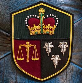 Denman and Goddard logo badge