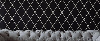 kaboompics_Elegant grey sofa by the wall