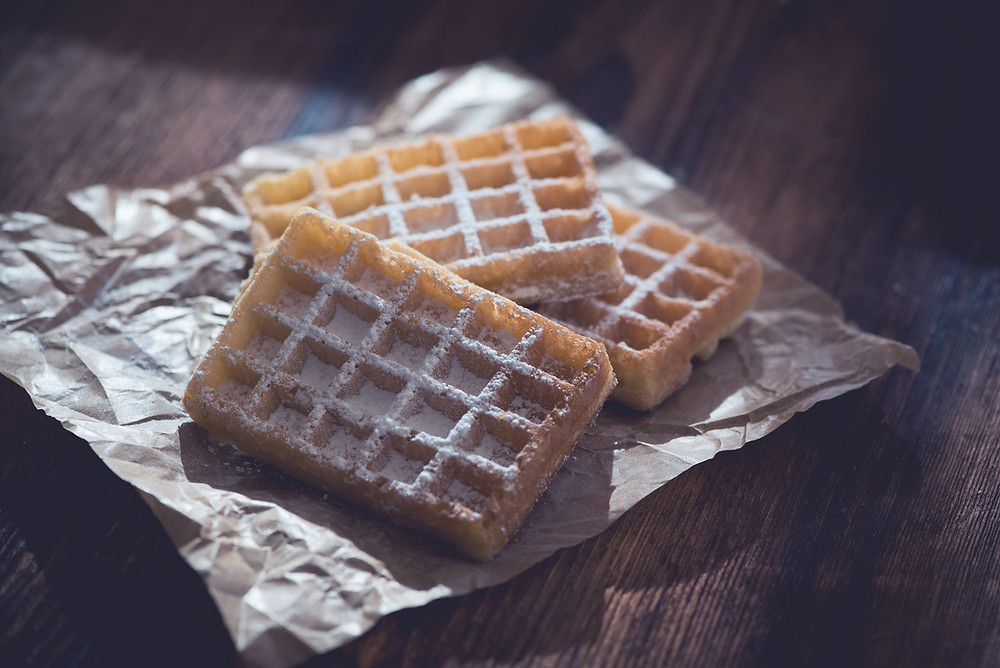waffles on tinfoil, showing food you may eat when money is tight