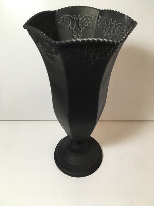 large vase with design on top
