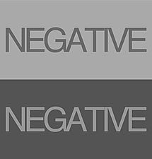 negative times grau.jpg